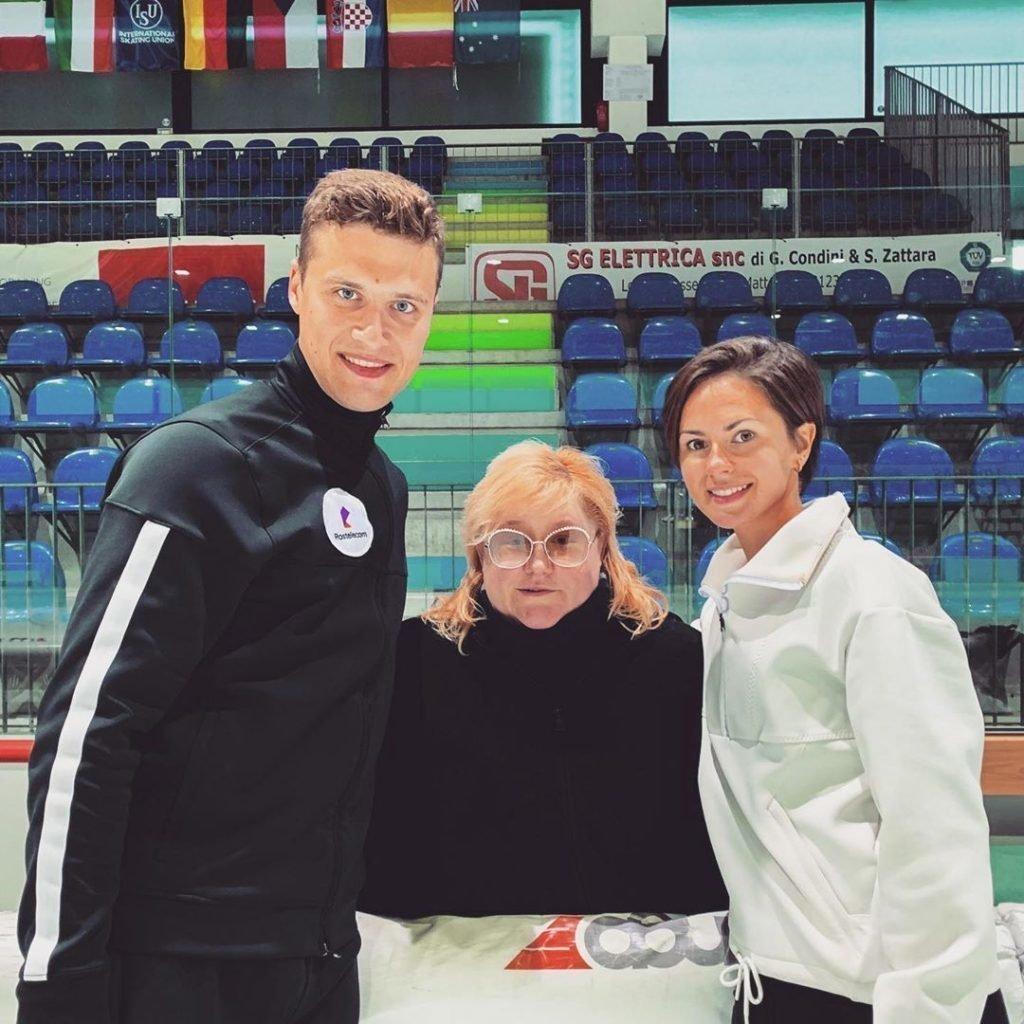 Александр Энберт с тренером и партнершей