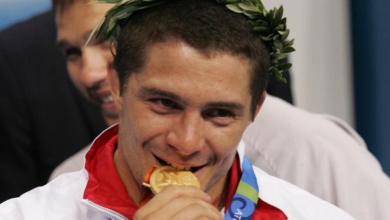 Алексей Мишин с олимпийской медалью